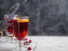 Red Tea With Raspberries In Glass