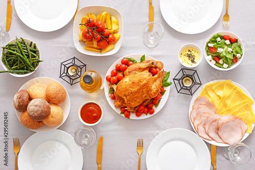 Tuinposter Kruidenierswinkel Table set for big family dinner