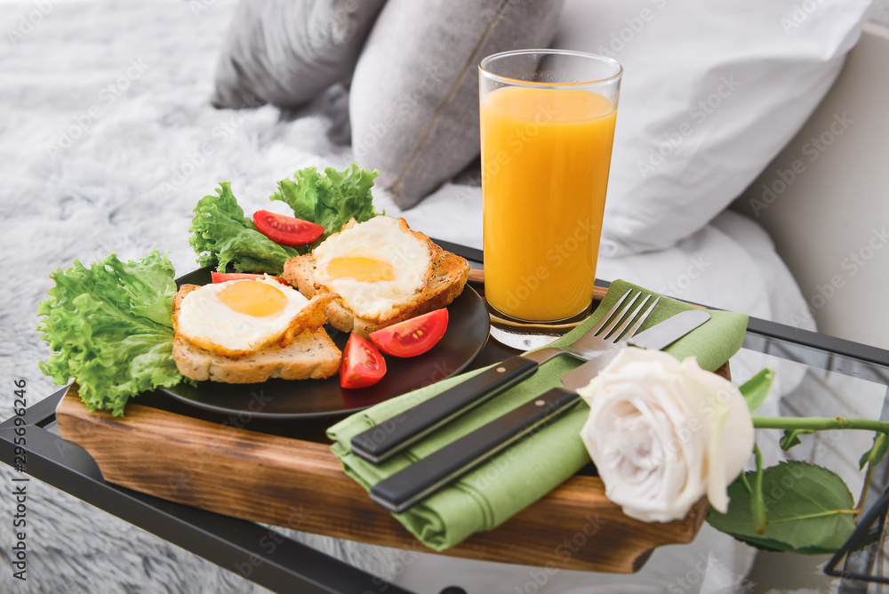 Fototapety, obrazy: Tray with tasty breakfast on table in bedroom