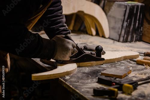 Fototapeta Carpenter working with plane obraz na płótnie