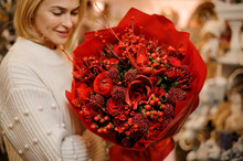 Smiling Girl Holding A Bouquet Of Saturated Red Flowers