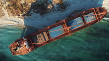 Cargo Ship Run Aground At Sea Coastline Near Novorossiysk And Gelendzhik. Shipwreck Accident Of Nautical Vessel After Huge Sea Storm, Aerial View From Drone
