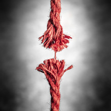 Frayed Red Rope Hanging By Las...