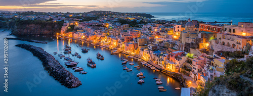 Panoramic sight of the beautiful island of Procida in the evening, near Napoli, Campania region, Italy.