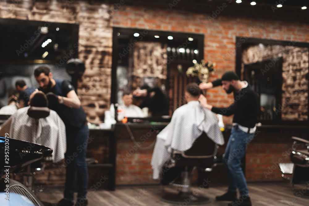 Fototapety, obrazy: Haircut head in barbershop. Barber cuts the hair on the head of the client. The process of creating hairstyles for men. Barber shop. Selective focus.