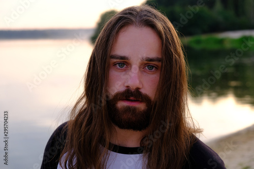Portrait of handsome bearded young man with long hair Wallpaper Mural