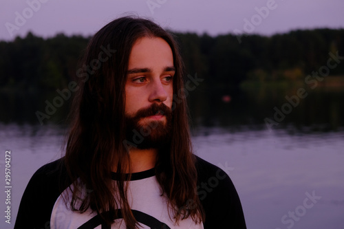 Portrait of handsome bearded young man with long hair Canvas Print