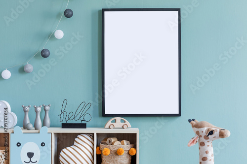 Obraz Stylish scandinavian newborn baby room with wooden cabinet, toys, mock up poster frame and children's accessories. Modern interior with eucalyptus background wall and cottona balls. Modern home decor. - fototapety do salonu