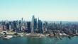 Aerial of Hudson Bay, high view of Manhattan cityscape, skyscrapers and landmark buildings, New York City at daytime, ships crossing cannel