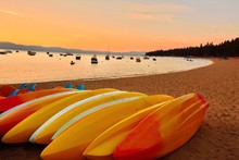 Colorful Kayaks Resting On The...