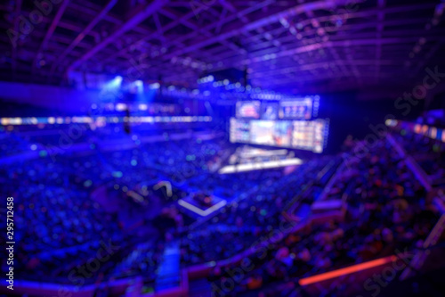 Blurred background of an esports event - The winner of tournament team on a stage with a cup award Poster Mural XXL