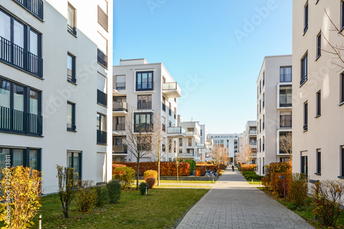 Spoed Foto op Canvas Bleke violet Modern apartment buildings in a green residential area in the city