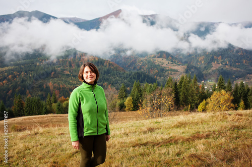 Hiker woman in moumtains in autumn Wallpaper Mural