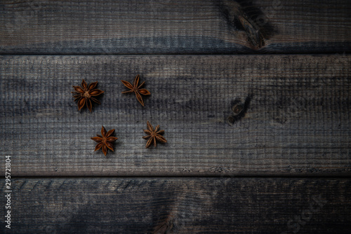 Photo  Anise stars on a dark wooden table