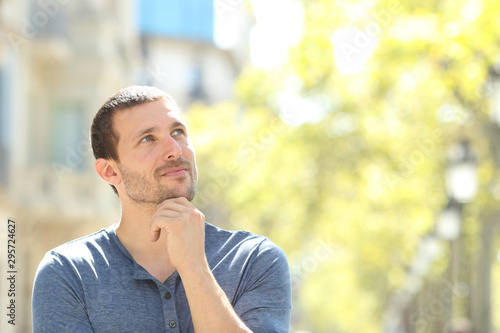 Canvastavla Serious adult man thinking looking at side in the street