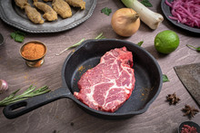 Raw Chuck Steak Marbled Beef On Frying Pan