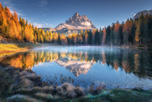 Lake With Reflection Of Mountains At Sunrise In Autumn In Dolomites, Italy. Landscape With Antorno Lake, Blue Fog Over The Water, Trees With Orange Leaves And High Rocks In Fall. Colorful Forest