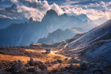 Small House In Beautiful Mountain Valley, Orange Grass, Stones, Blue Sky With Clouds At Sunset In Autumn. Colorful Landscape With Building, Mountains. Tre Cime Park In Dolomites, Italy. Alps In Fall