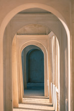 Archway With A Play Of Light And Shadow In Eastern Style. Gallery Of Arches In Perspective In Sunlight