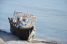 Old Abandoned Fishing Schooner On The Seashore.