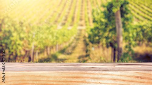 Foto auf Gartenposter Gelb Wooden flat Tabletop against vineyard hill in late summer
