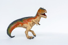 Dinosaur Toy Standing On White...