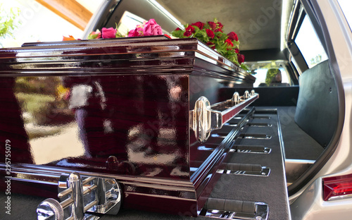 Photo closeup shot of a funeral casket in a hearse or chapel or burial at cemetery