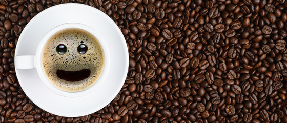 panoramic coffee background of a cup of black coffee with smiling face coffee...