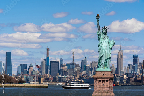 The Statue of Liberty over the Scene of New york cityscape river side which location is lower manhattan,Architecture and building with tourist concept - 295766457