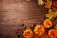 Autumn Thanksgiving Background. Pumpkins, Acorns And Leaves On Rustic Table Top View.