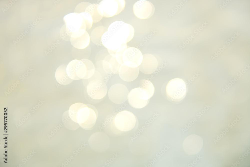 Soft focus bokeh light effects over a rippled