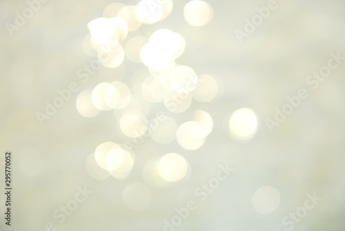 Soft focus bokeh light effects over a rippled