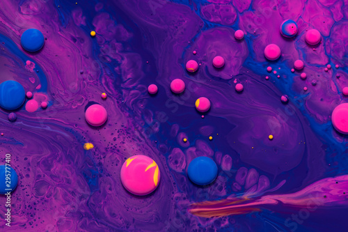 Acrylic paint balls abstract texture. Purple, blue and pink liquids mix. Creative multicolor background. Bright colors fluid, flowing wallpaper design. Mixed pigments violet backdrop. - 295777410
