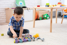 Adorable Little Boy Playing Wi...