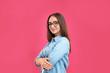 Leinwandbild Motiv Beautiful young woman with glasses on crimson background