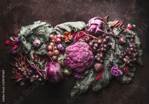 Purple fruits and vegetables setting. Anthocyanins health benefits as dietary antioxidants. Top view. Flat lay. - 295787683