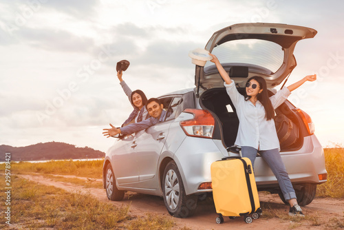 Fototapeta  Happy asian group of friends car travel driving and suitcase at mountain lake ri