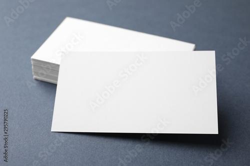 Fototapeta Blank business cards on dark grey background, closeup. Mock up for design obraz