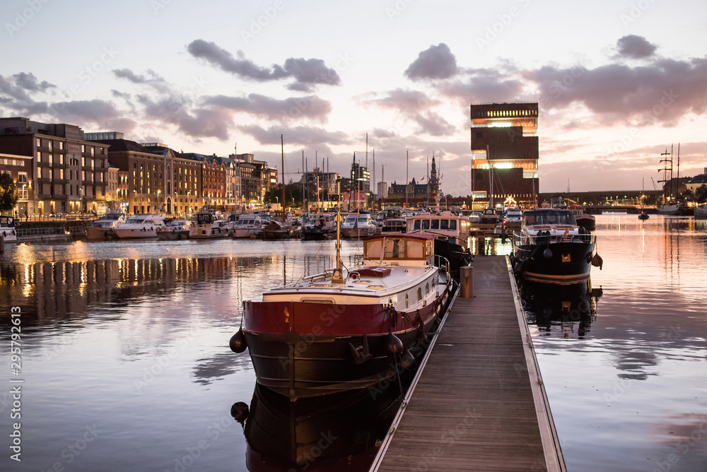 Fototapety, obrazy:  Antwerpen, Belgium, beautiful night view of modern Eilandje area and port. Small island district and sailing marine at sunset. Popular travel destination and tourist attraction