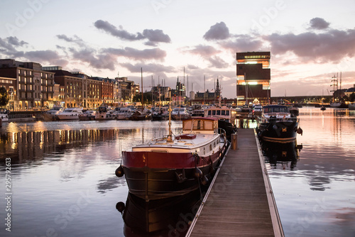 Keuken foto achterwand Antwerpen Antwerpen, Belgium, beautiful night view of modern Eilandje area and port. Small island district and sailing marine at sunset. Popular travel destination and tourist attraction