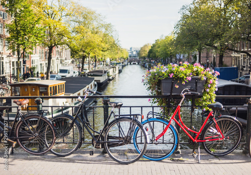 Fototapety, obrazy: Charming canal with boat houses and bicycles in Amsterdam old town, Netherlands. Popular travel destination and tourist attraction. City life concept