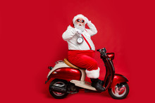 Profile Side View Of Nice Bearded Worried Funky Santa Sitting On Moped Holding In Hand Clock Countdown Winter Discount Sale Isolated On Bright Vivid Shine Vibrant Red Color Background