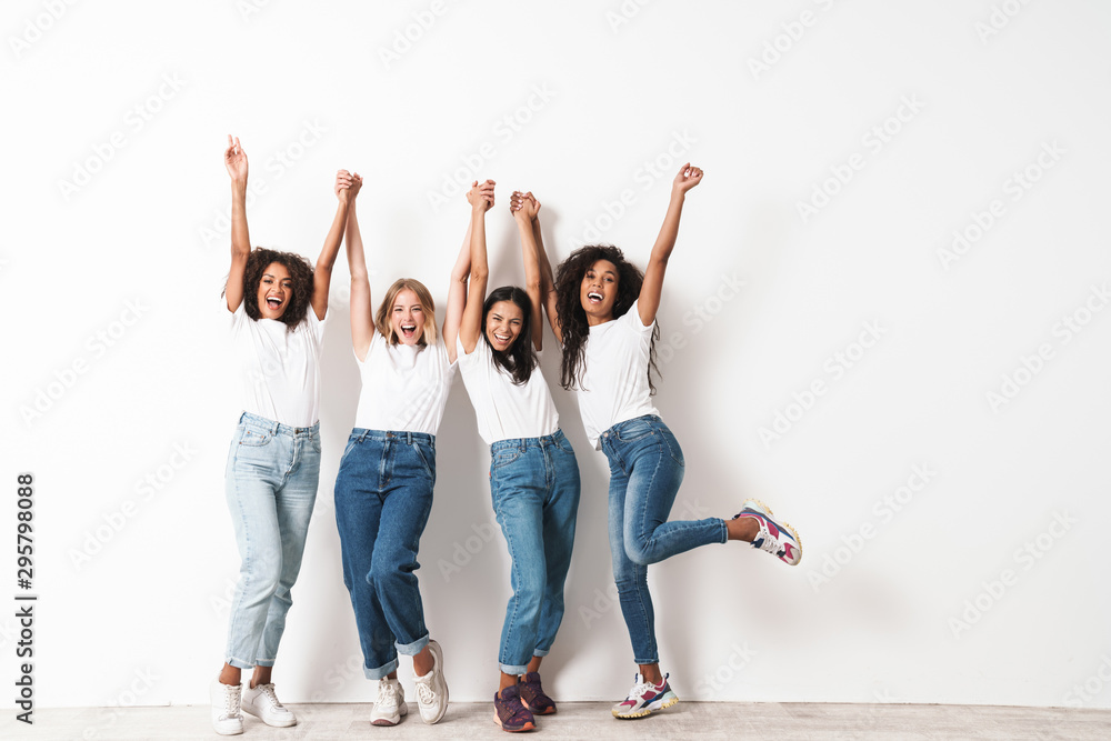 Fototapeta Optimistic cheery young women multiracial friends