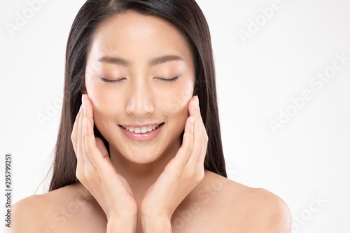 Beautiful Asian young woman touching soft cheek smile with clean and fresh skin Wallpaper Mural