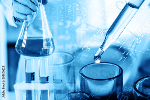 Fotografie, Tablou  hand of scientist holding flask with lab glassware and test tubes in chemical la