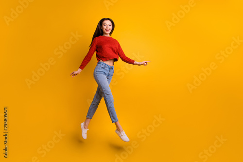 Fototapety, obrazy: Full length body size photo of cheerful cute nice charming fascinating girlfriend running for sales jumping up wearing sneakes isolated over yellow vivid color background