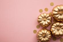 Beautiful Golden Pumpkins On Pastel Pink. Flat Lay Thanksgiving Composition
