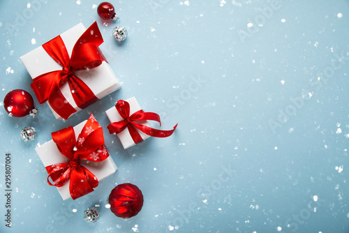 Fototapeta Christmas and New Year holiday background. Xmas greeting card. Christmas gifts on blue background top view. Flat lay	 obraz na płótnie