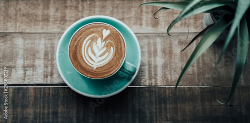 Top view latte art coffee on wooden table in cafe Poster Mural XXL
