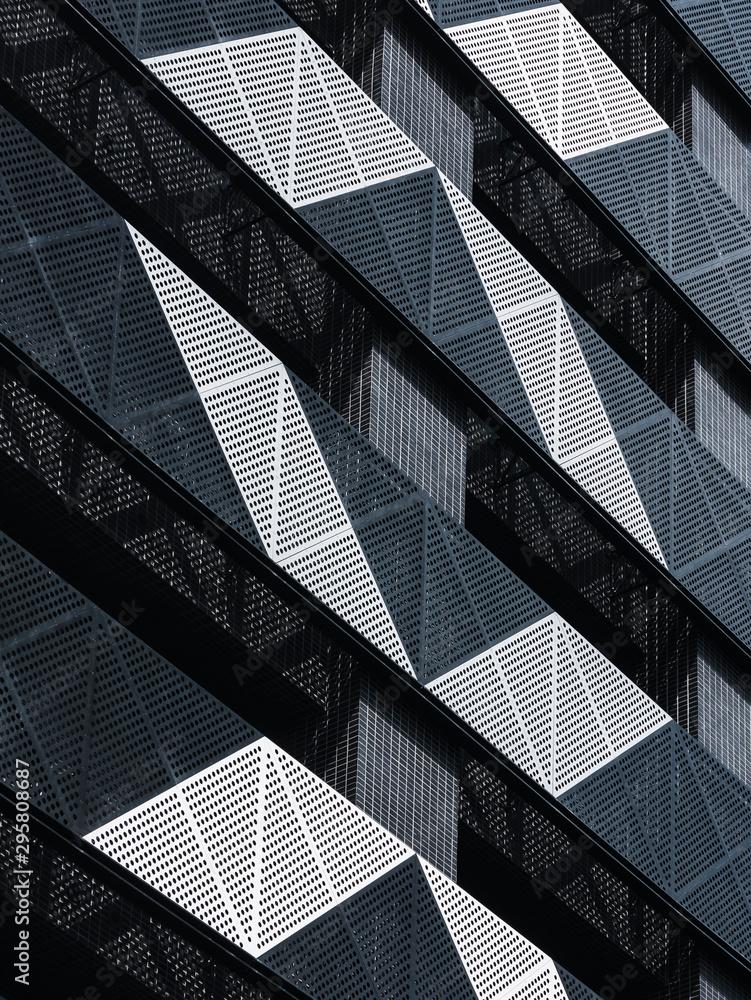 Fototapeta Steel Facade Modern building Metal sheet grill pattern Architecture details